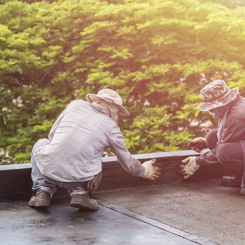 Roofers Repair a Flat Roof.